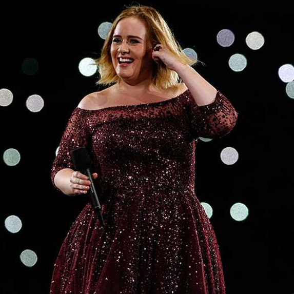 Adele on stage in red dress