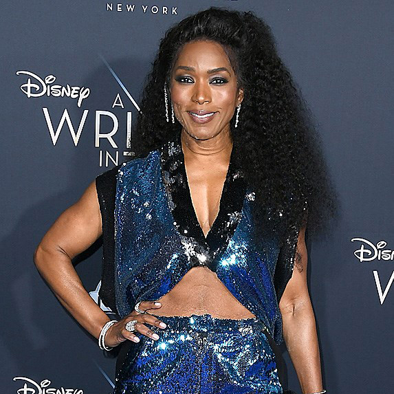 Angela Bassett in sparkly blue jumpsuit