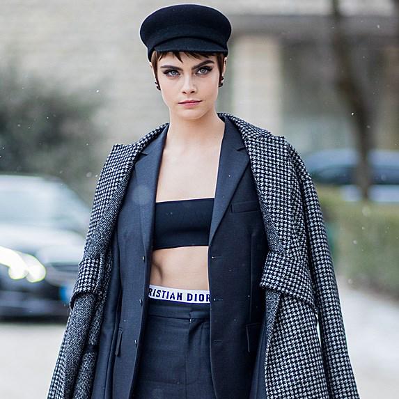 Cara Delevingne walking down the street in oversized coat