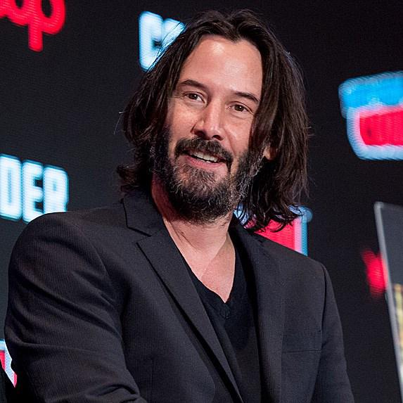 Keanu Reeves wearing suit jacket