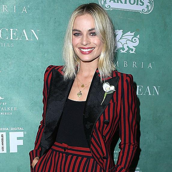 Margot Robbie wearing maroon suit