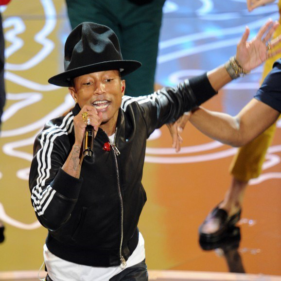 Pharrell Williams on stage singing