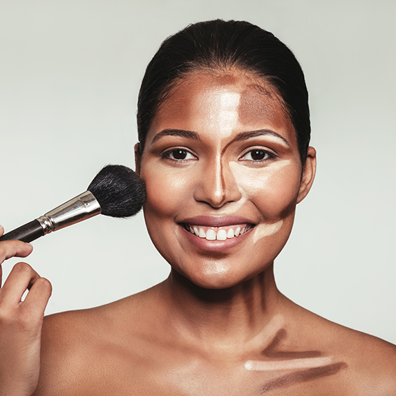 woman blending cream contour