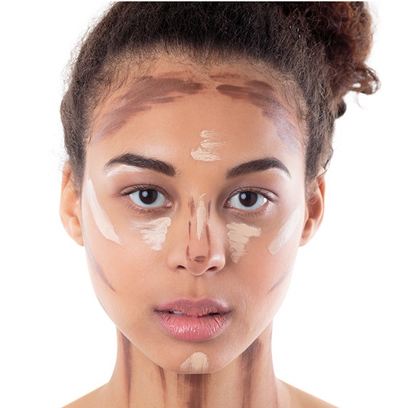 woman with dark skin looking overwhelmed by contouring