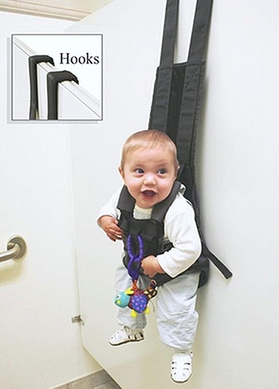 Baby hanging in pack on hook of back of door