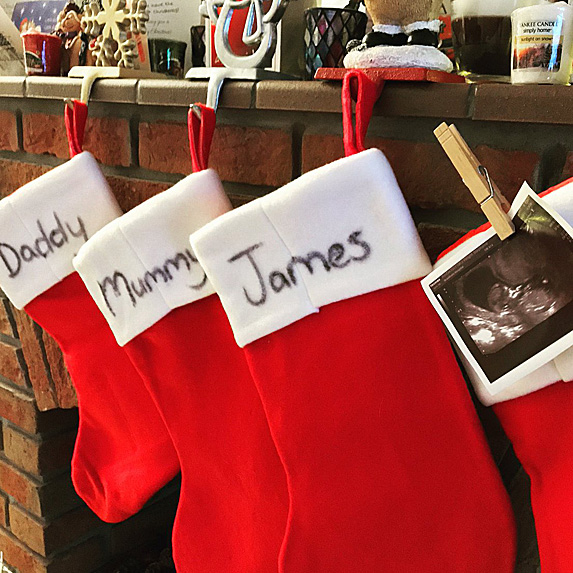Stockings with family's names and a sonogram