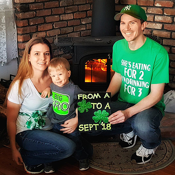 Parents and son celebrating St. Patrick's Day and new baby