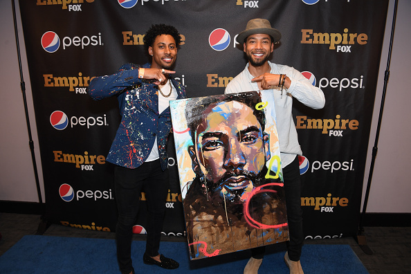 Jon and Jussie Smollett pose with a painting