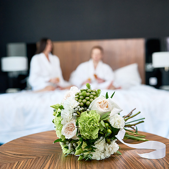 Couple in hotel room bed after wedding