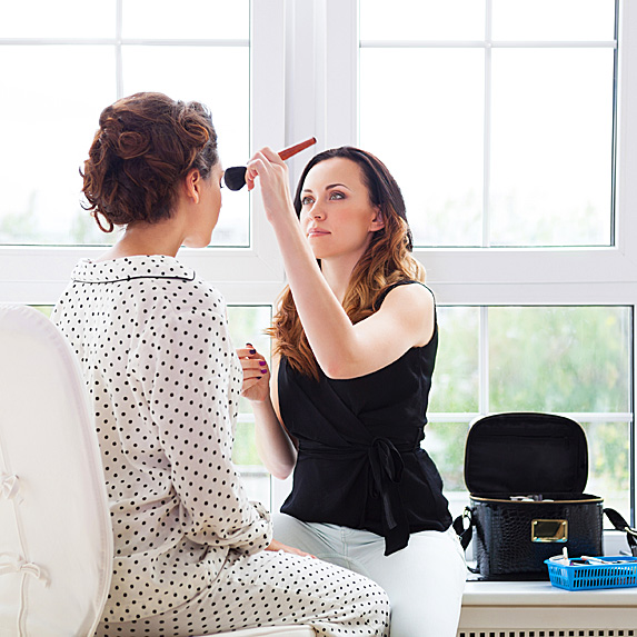 Makeup artist doing bride's makeup