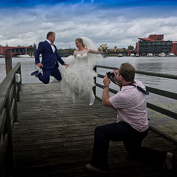 Photographer snapping bride and groom