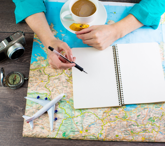 Travel planning tools spread out on a tabletop