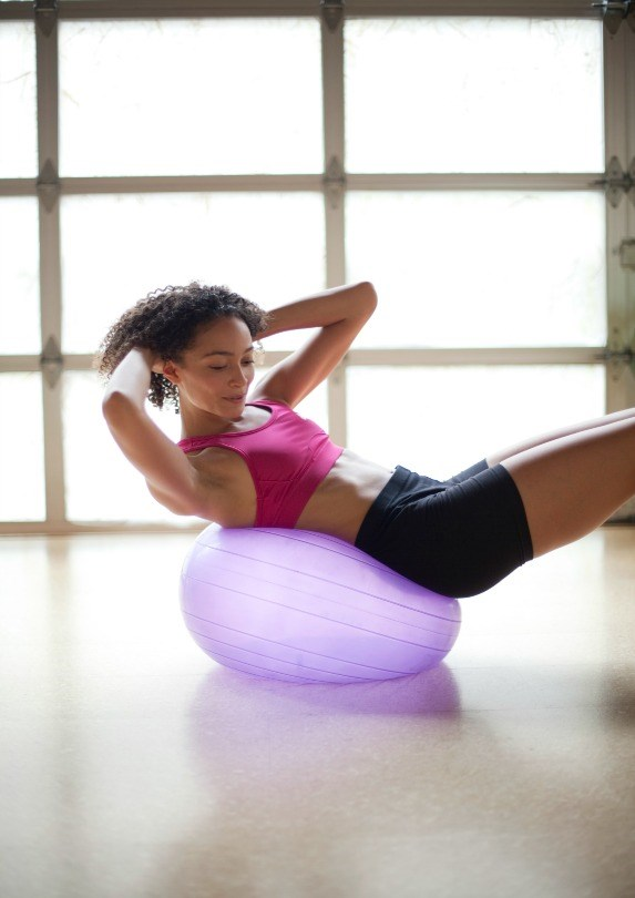 woman exercising on yoga ball