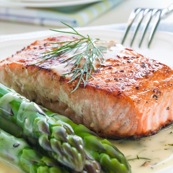 grilled salmon steak served with asparagus