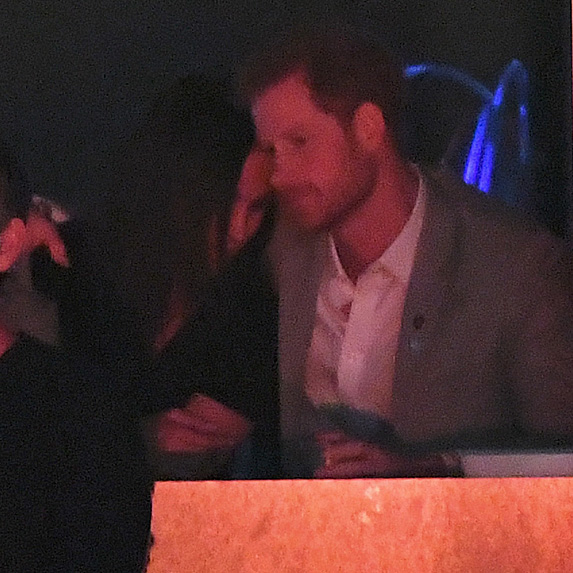 Meghan Markle and Prince Harry cuddle up in Toronto