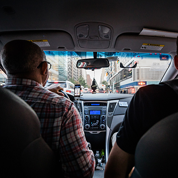 Backseat view of Uber driver