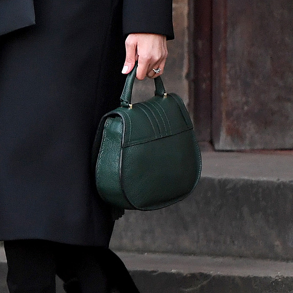 Closeup of green bag Meghan Markle is holding