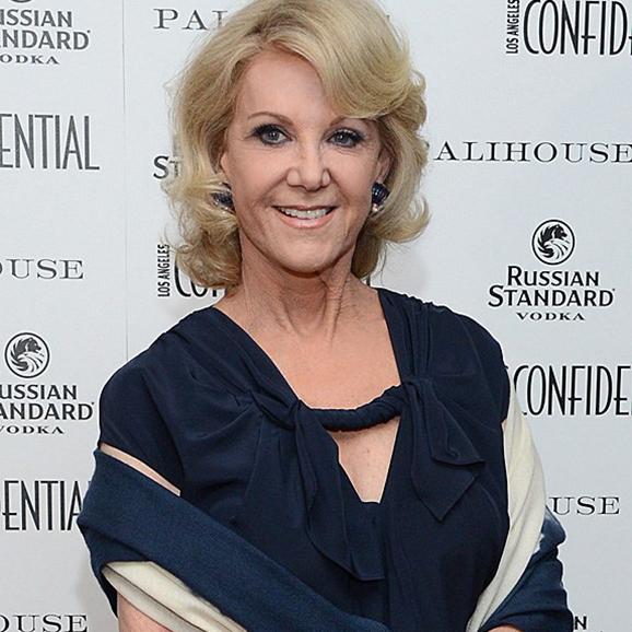 Elaine Wynn standing in formal-wear, smiling