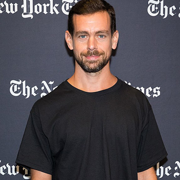 Jack Dorsey standing in a black t-shirt
