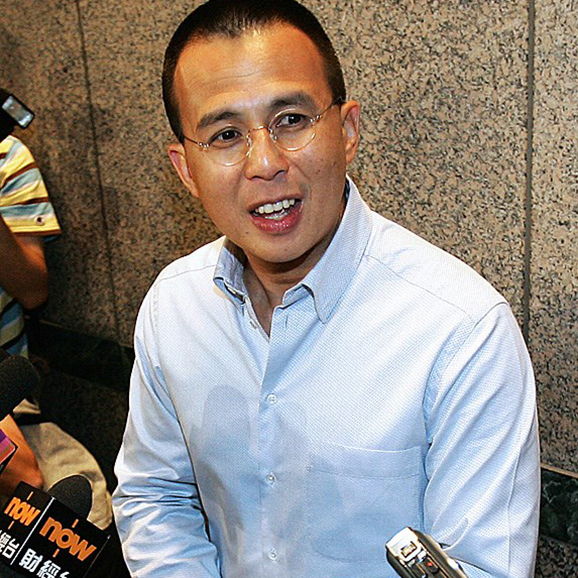 Richard Li looking off-camera, mid-sentence