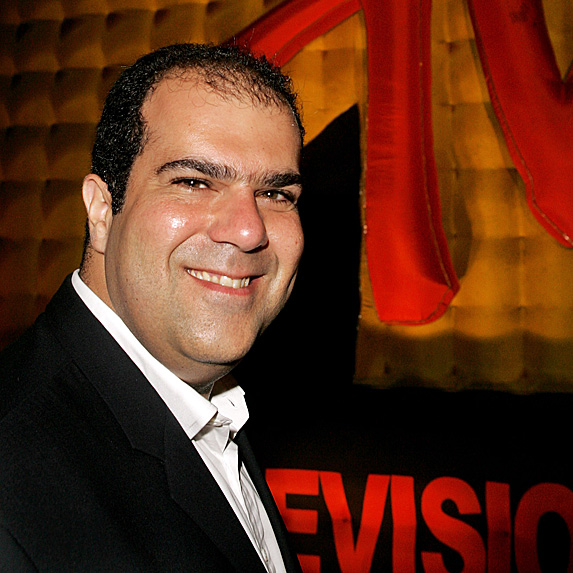 Stelios Haji-Ioannou at an event, smiling at the camera