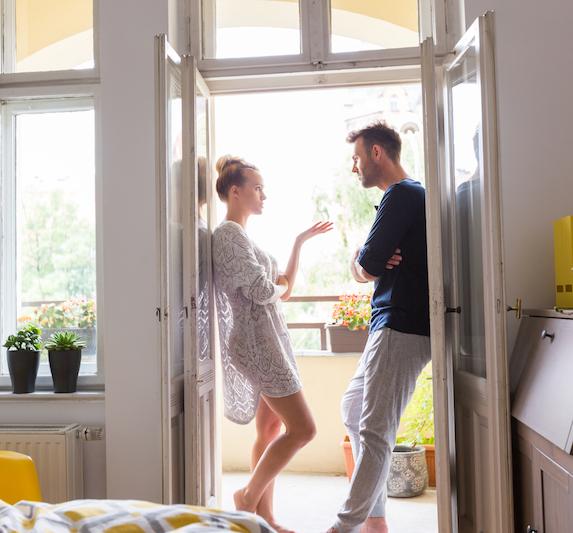 Couple talking in a patio doorway
