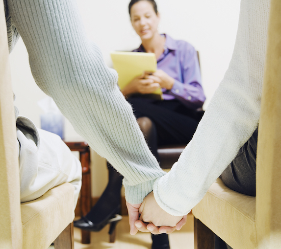 Couple in therapy, holding hands