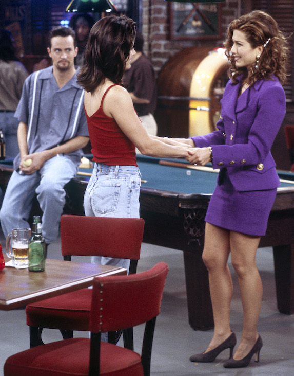 Jennifer Aniston, as character Rachel Green on 'Friends' wears a purple two-piece skirt suit and matching pumps