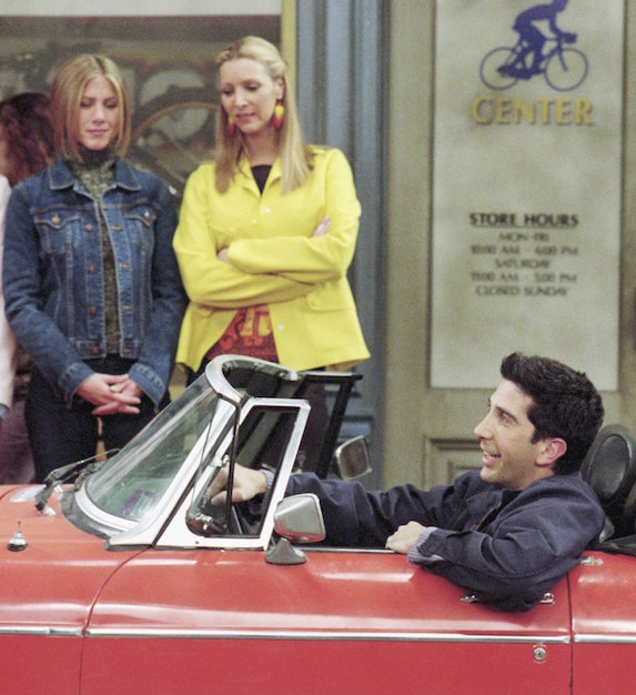 Jennifer Aniston, as character Rachel Green on 'Friends' wears a denim jacket and dark-wash jeans