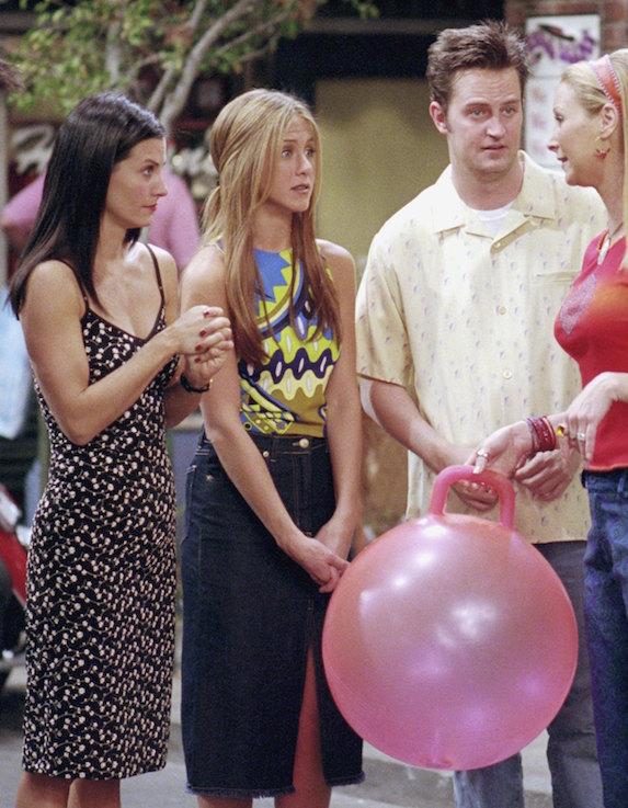 Jennifer Aniston, as character Rachel Green on 'Friends' wears a dark denim midi skirt and multicoloured top