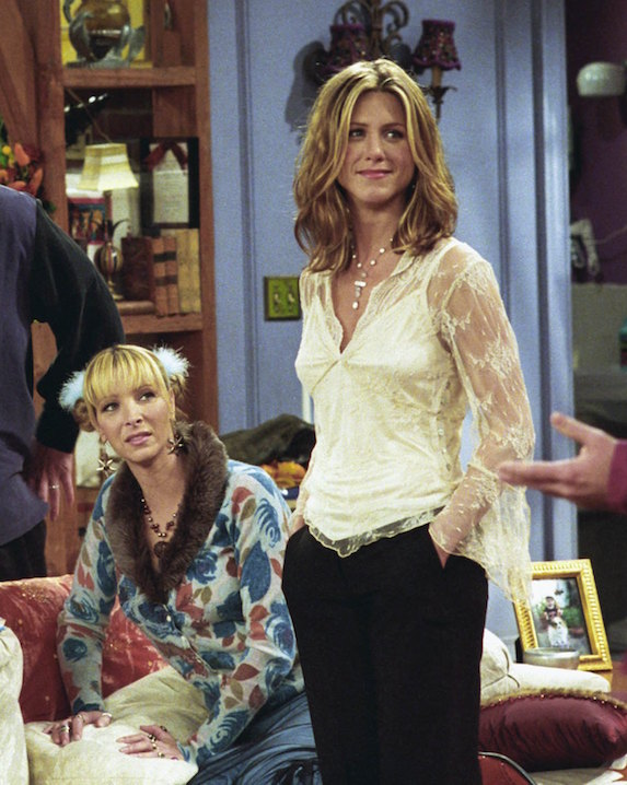 Jennifer Aniston, as character Rachel Green on 'Friends' wears black pants with an embroidered layered blouse