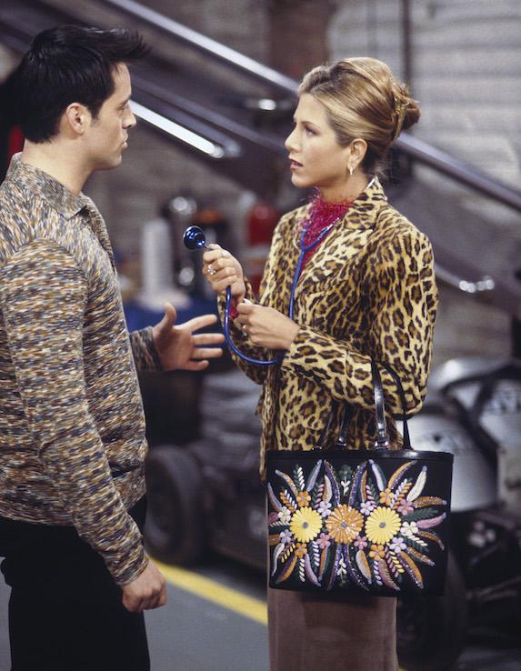 Jennifer Aniston, as character Rachel Green on 'Friends' wears a long skirt, pink top, embellished handbag and leopard-print jacket overtop
