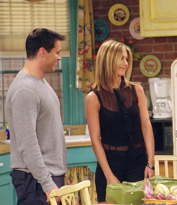 Jennifer Aniston, as character Rachel Green on 'Friends' wears a sheer sleeveless black top with black pants