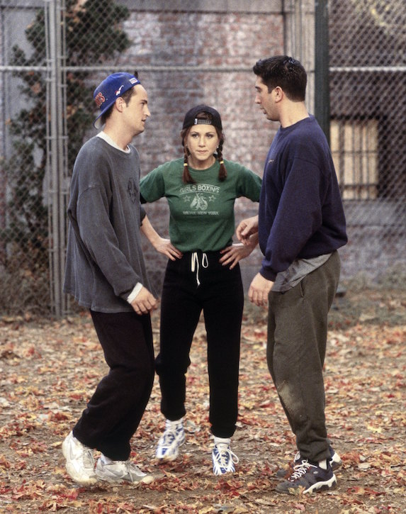 Jennifer Aniston, as character Rachel Green on 'Friends' wears sweatpants, sneakers, a green t-shirt and backwards cap