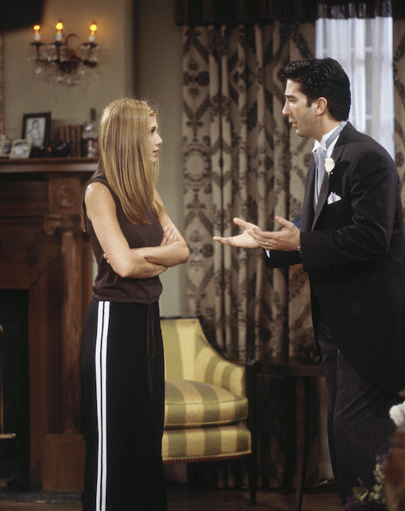 Jennifer Aniston, as character Rachel Green on 'Friends' wears casual loose-fitting pants with stripe details down the side and a sleeveless drawstring top