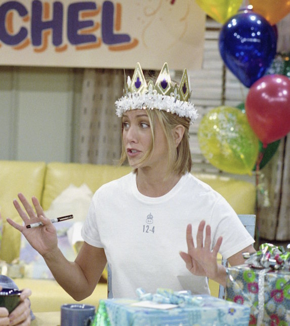 Jennifer Aniston, as character Rachel Green on 'Friends' wears a birthday crown and white t-shirt