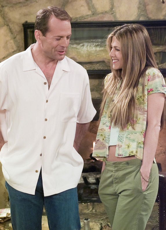 Jennifer Aniston, as character Rachel Green on 'Friends' wears low-rise pants, a white tank top and printed short-sleeved shirt, worn open overtop