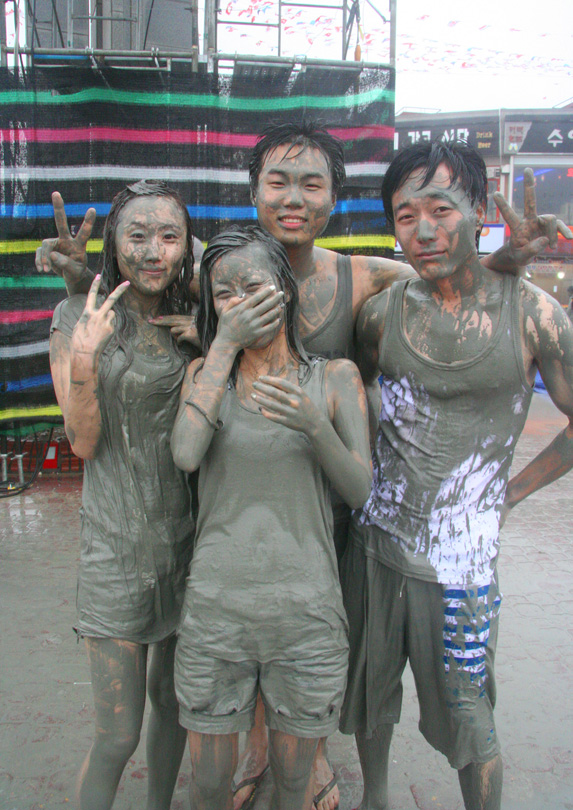 Tourists covered in mud