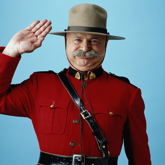 A Canadian Mountie saluting