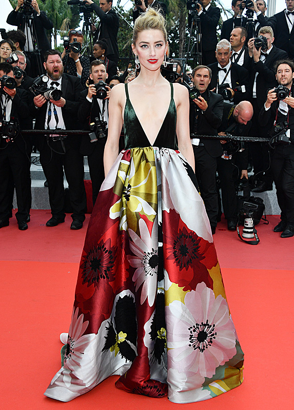 Amber Heard posing on red carpet at Cannes