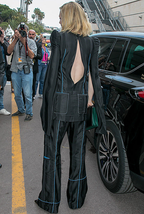 Rear shot of Cate Blanchett in a suit