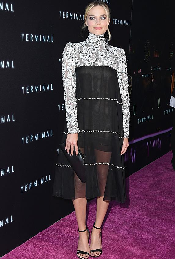 Margot Robbie posing on red carpet