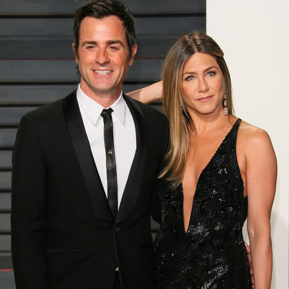 Jennifer Aniston and Justin Theroux posing at a formal event together