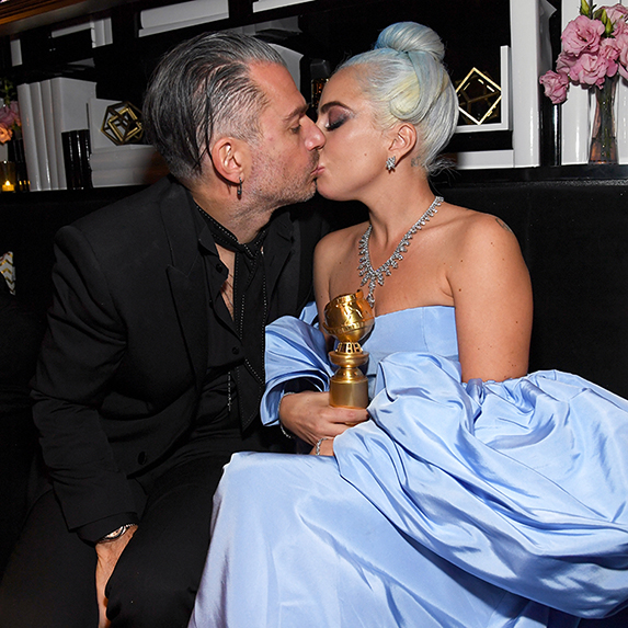 Christian Carino and Lady Gaga at an after-party, kissing