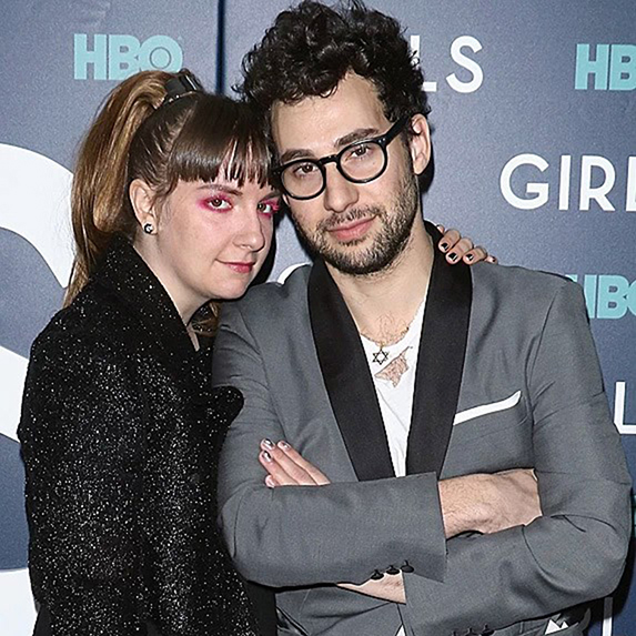 Lena Dunham and Jack Antonoff posing together at an event