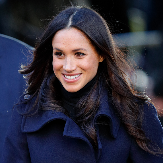 meghan markle in blue coat with blowout