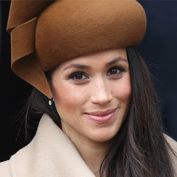 meghan markle in brown hat with soft, arched brows