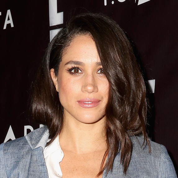 meghan markle in grey jacket with loose waves in hair
