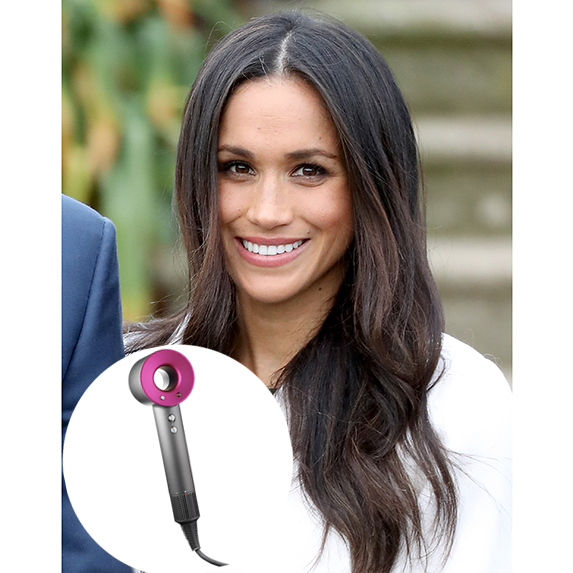 meghan markle in white coat with blowout photo of dyson hair dryer superimposed