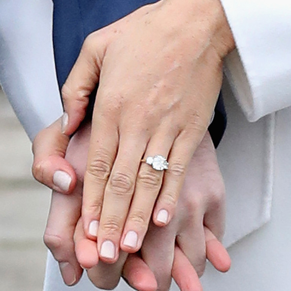 closeup of meghan markle's hand with engagement ring and short, squared nude nails